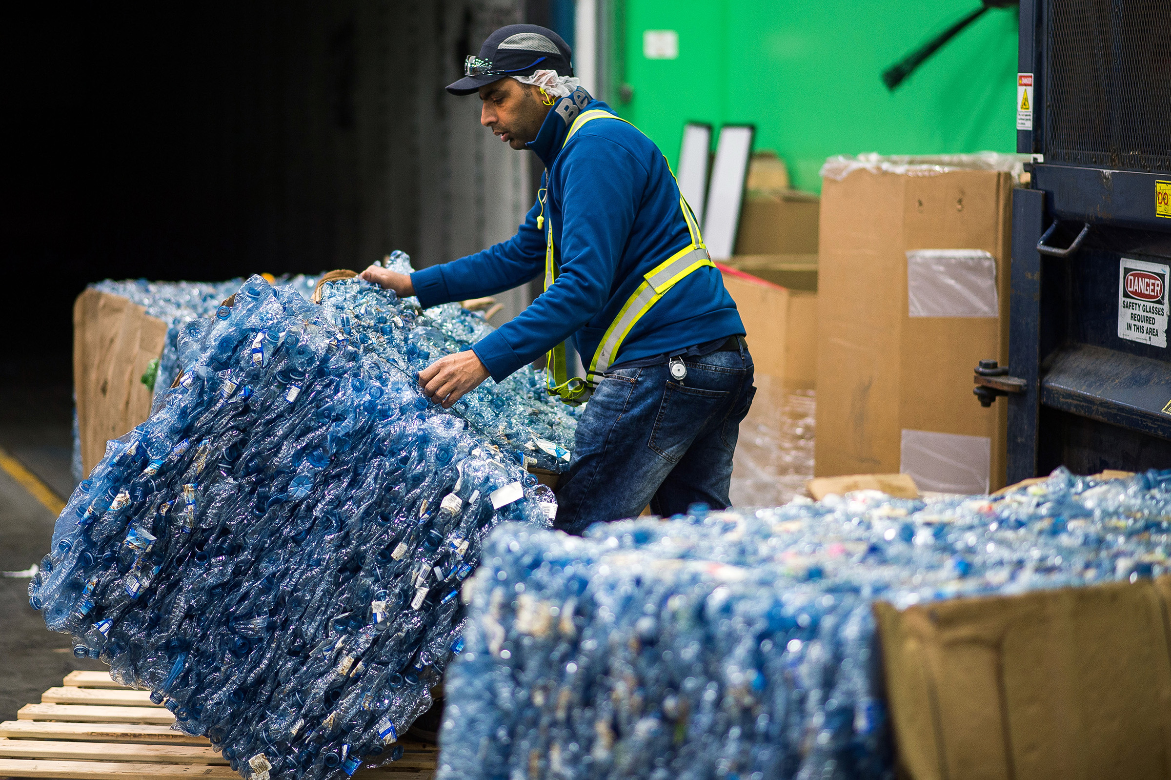 A worker moves a bundle of crushed plastic water bottles to be shipped to the Ice River Springs Water Co. Inc. recycling facility in Chilliwack, Canada, on Nov. 18, 2019.