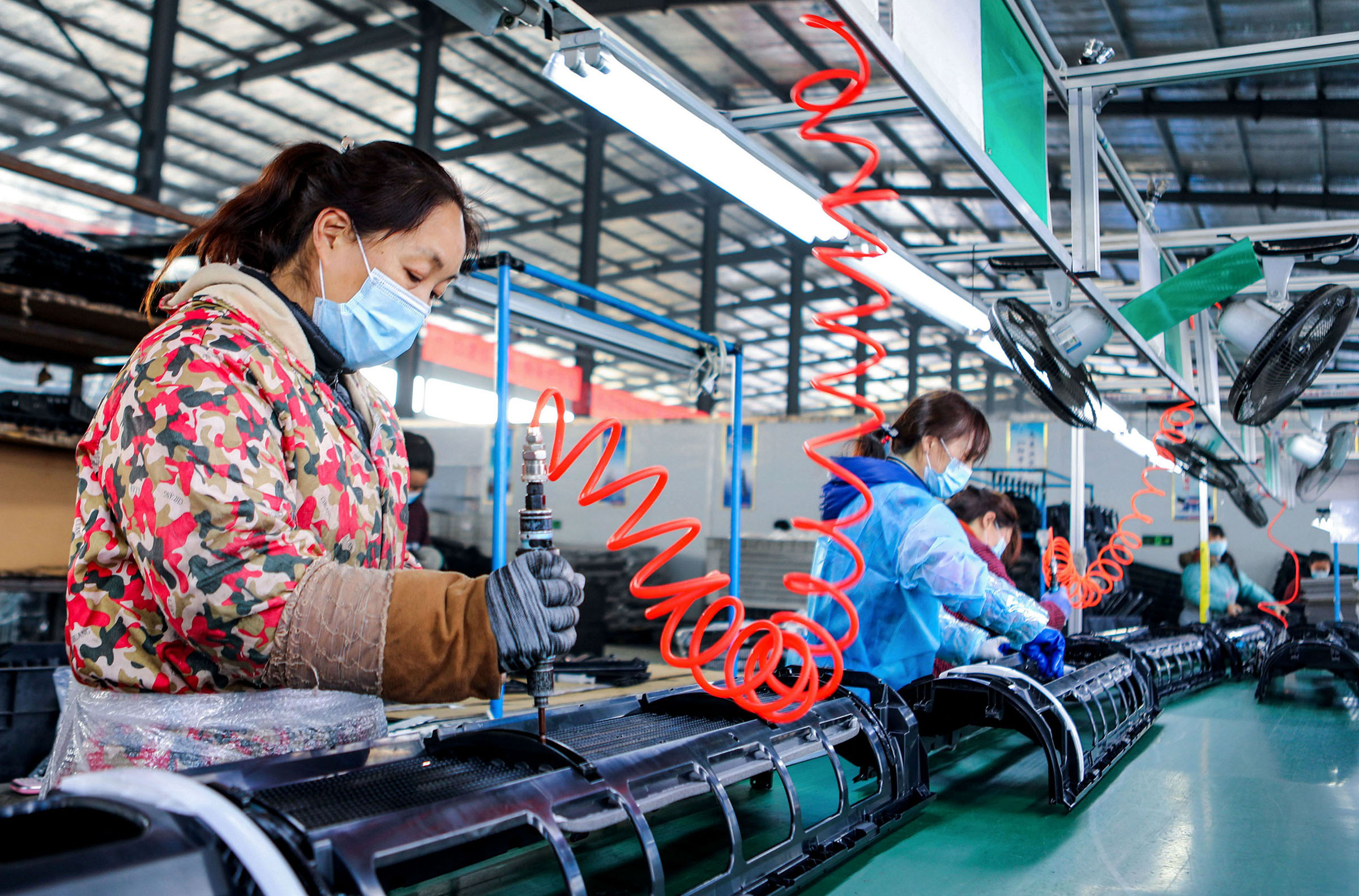 Workers at a plastic products company in Handan, in China's Hebei Province, on Feb. 25, 2020.