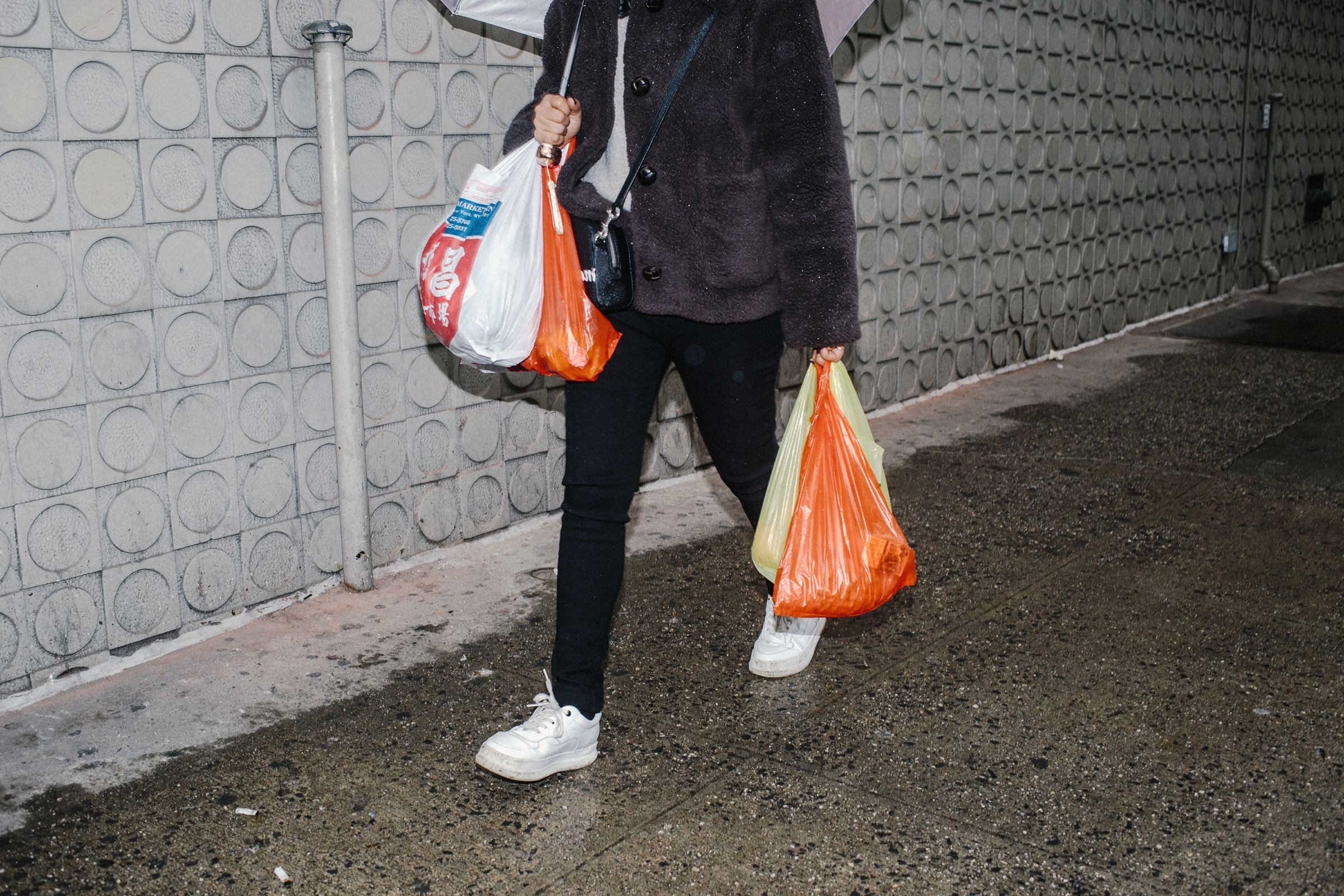 A woman carries plastic bags in New York on Feb. 25, 2020.