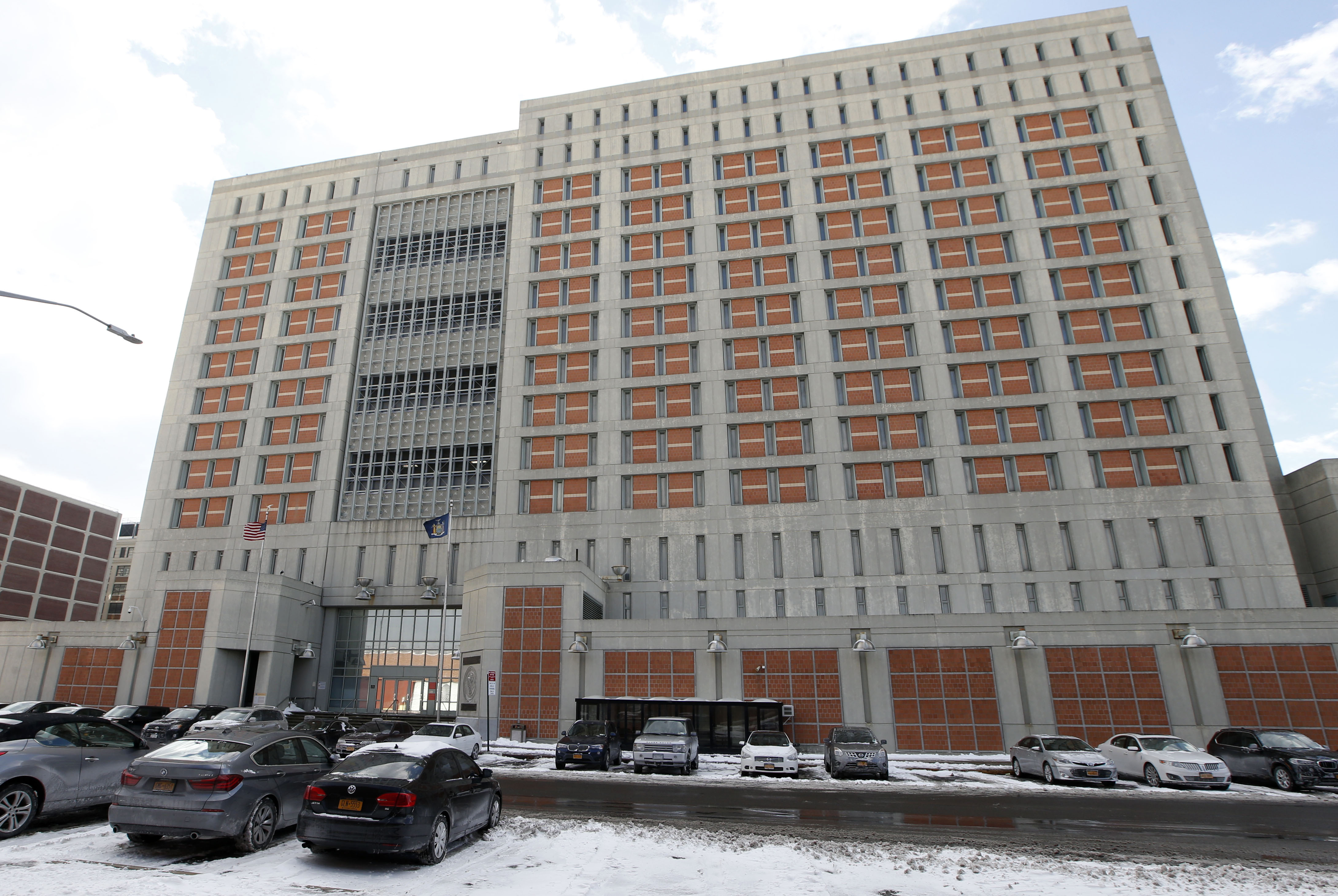 This Jan. 8, 2017 file photo shows the Metropolitan Detention Center in the Brooklyn borough of New York. The Federal Bureau of Prisons (BOP) has taken a new step in their attempt to stop the spread of coronavirus in their facilities by confining all inmates in their cells for 14 days.