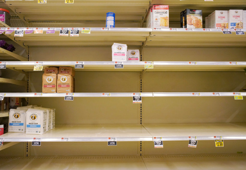 Shelves in the flour section are largely empty save for a few organic options at the Hannaford supermarket in Scarborough on Friday, March 27, 2020.