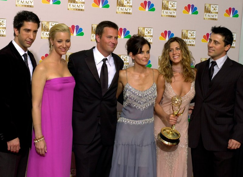 The cast of  Friends,  from left, David Schwimmer, Lisa Kudrow, Matthew Perry, Courteney Cox, Jennifer Aniston and Matt LeBlanc pose in the press room with the award for outstanding comedy series at the 54th annual Primetime Emmy Awards in Los Angeles on Sept. 22, 2002.