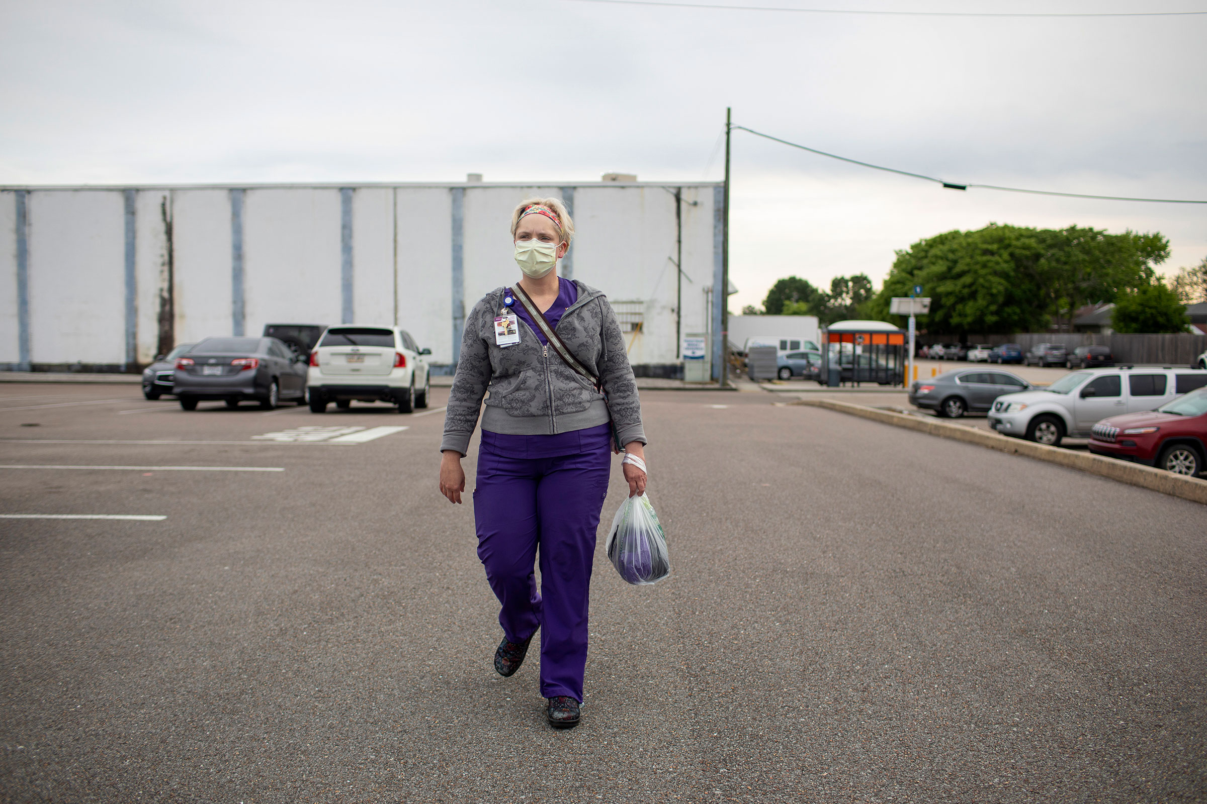 Laurie Halbrook walks to her car after a finishing a shift at Ochsner Medical Center in Jefferson Parish on April 2, 2020.