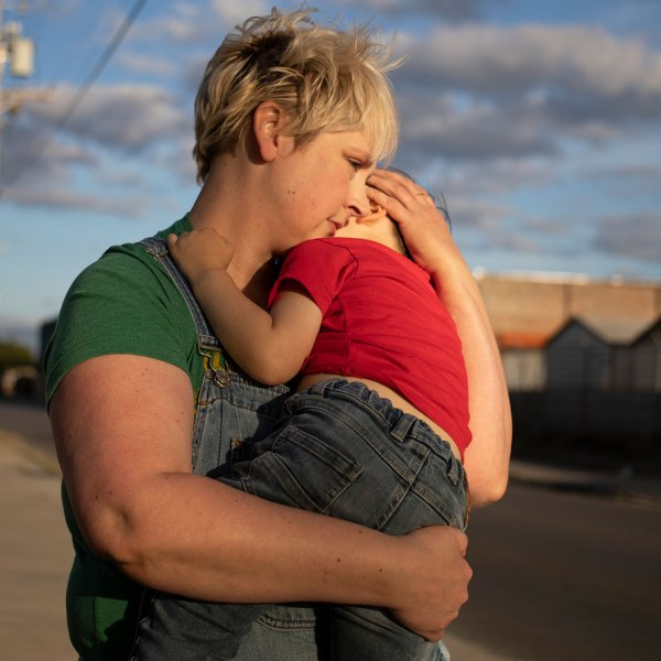 Laurie Halbrook holds her son Michael, 3, during a walk through their neighborhood in New Orleans.