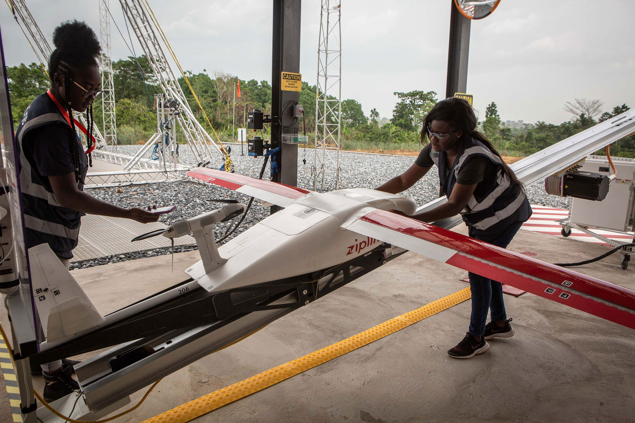 Staff members prepare a drone for the delivery of medical supplies at the drone delivery service base run by operator Zipline in Omenako, 40 miles north of Accra, Ghana on April 23, 2019.