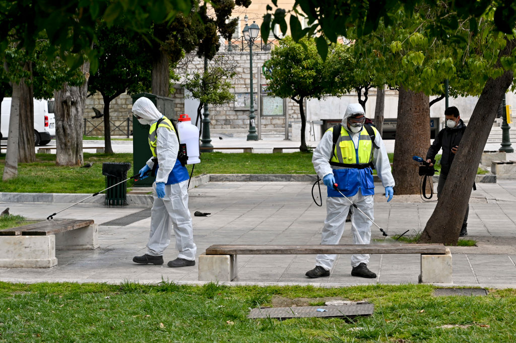 Municipal workers disinfect Syntagma square on March 23, 2020 in Athens, Greece.