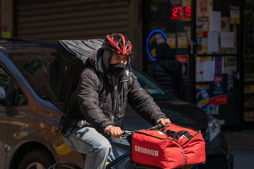 A food delivery courier for Grubhub wears a protective mask in New York, U.S., on Monday, April 6, 2020.
