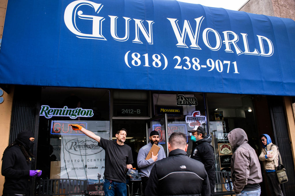 Shoppers wait in line to purchase ammunition and guns at Gun World in Burbank, California on March 17.