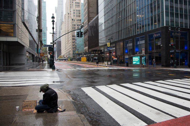 A homeless person sits in the rain on April 24, 2020 in New York City.