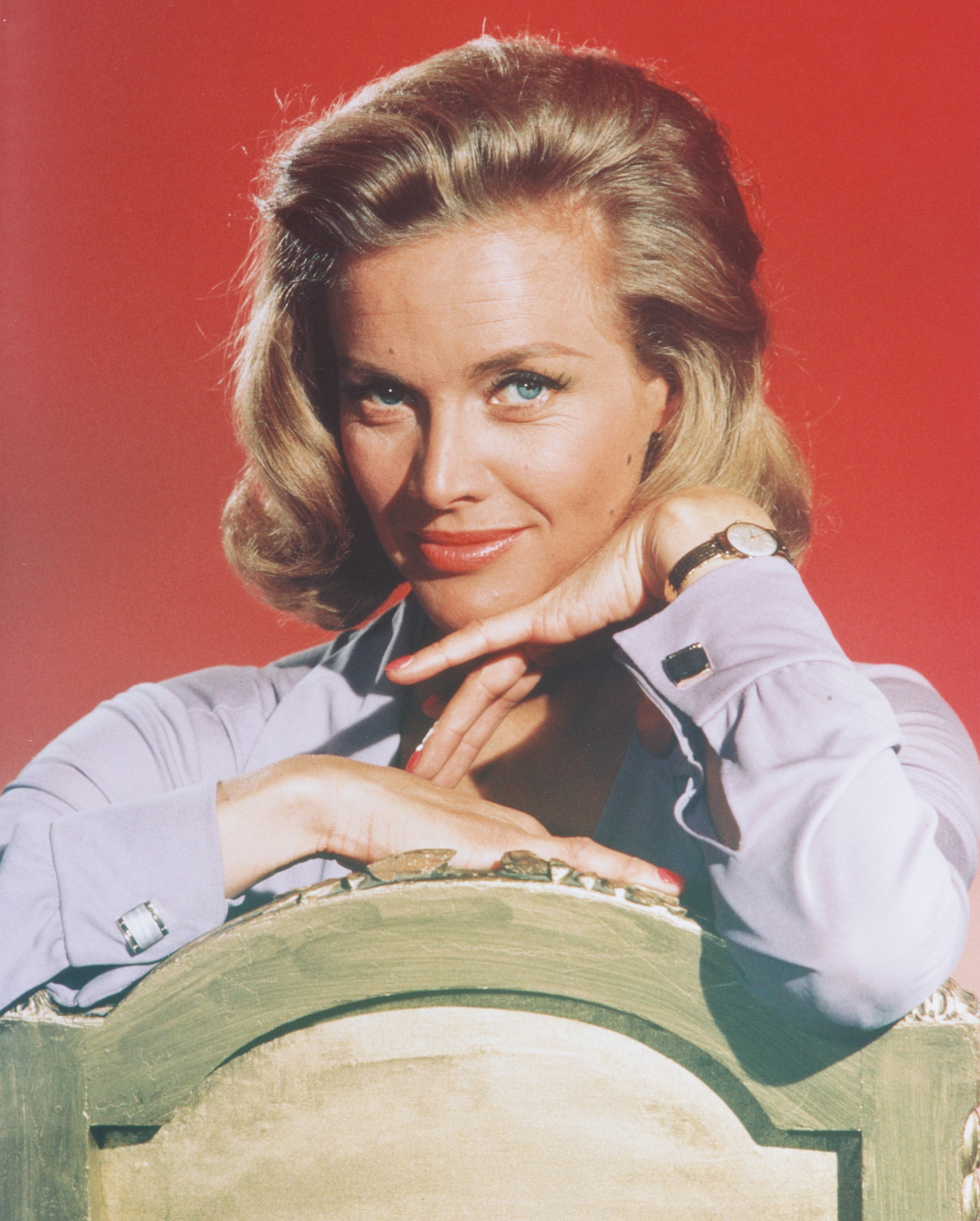 Honor Blackman poses in a studio portrait  issued as publicity for the film, 'Goldfinger', circa 1964.