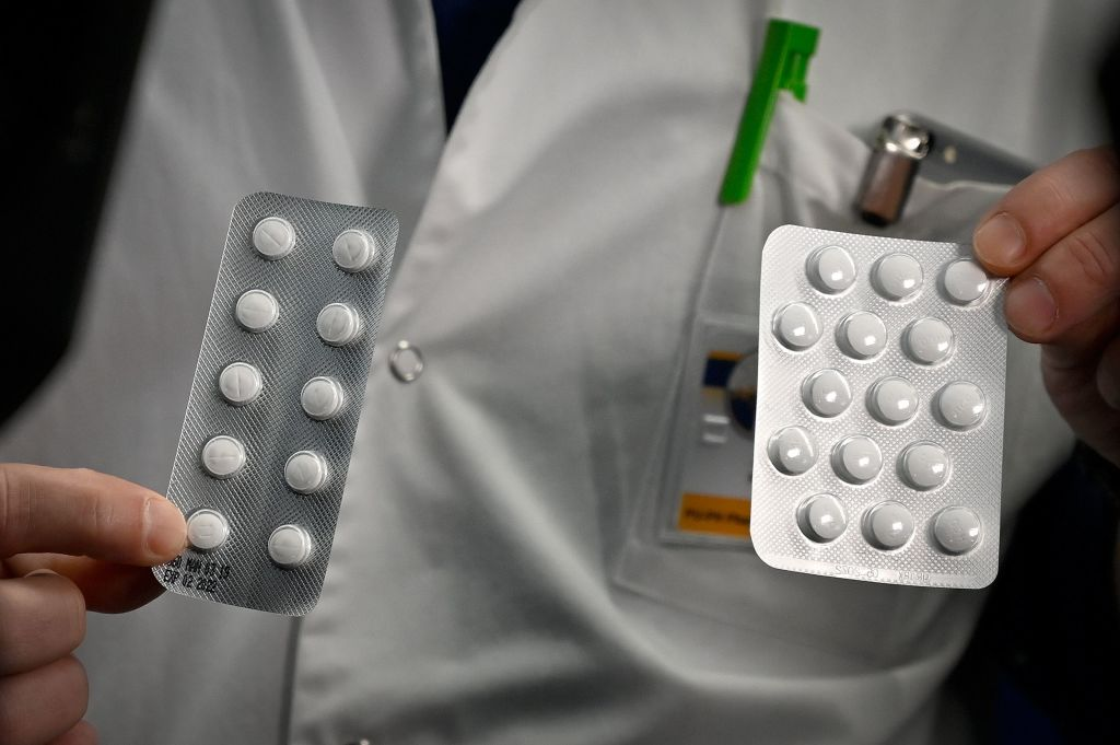 Medical staff show packets of a Nivaquine, tablets containing chloroquine and Plaqueril, tablets containing hydroxychloroquine, at the Mediterranee infection Institute in Marseille, France on Feb. 26, 2020.