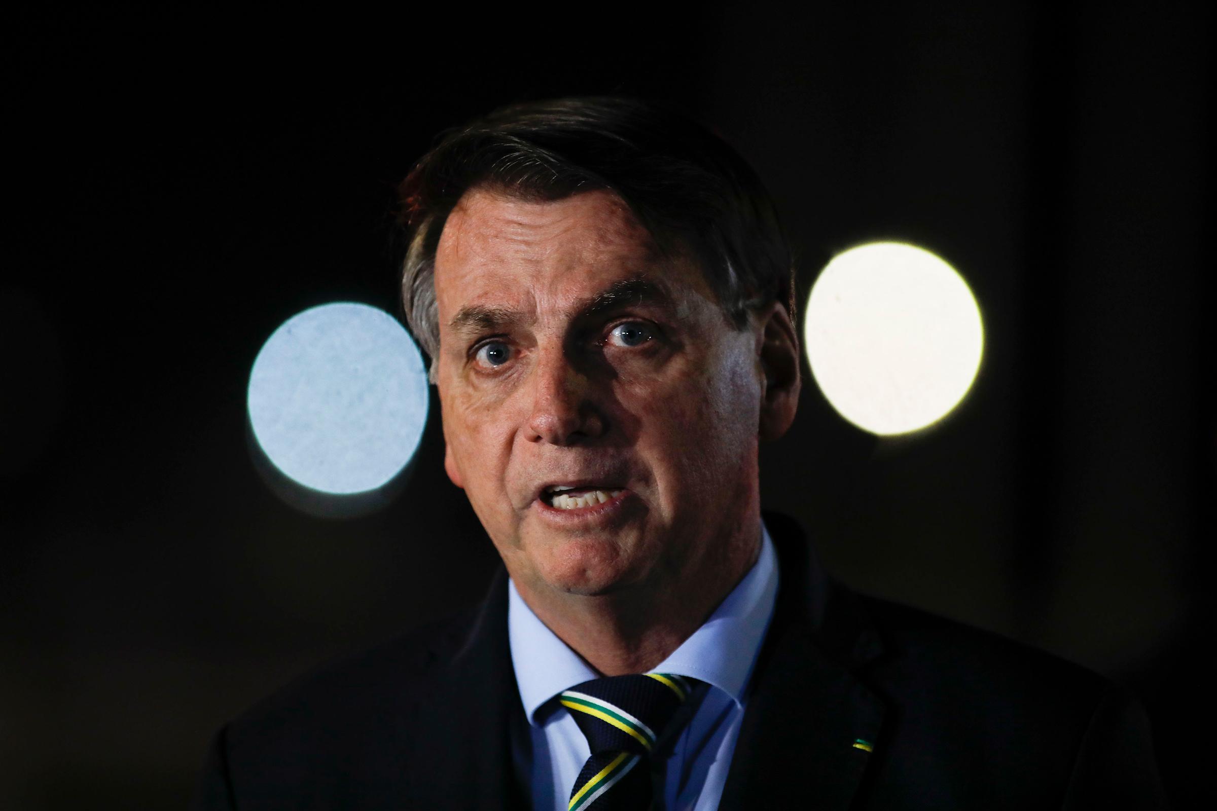 Brazil's President Jair Bolsonaro delivers a  press conference at Palacio da Alvorada da presidencial residence on April 16