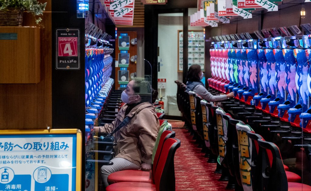 Tokyo Reluctantly Shuts Some Businesses as Coronavirus Cases...