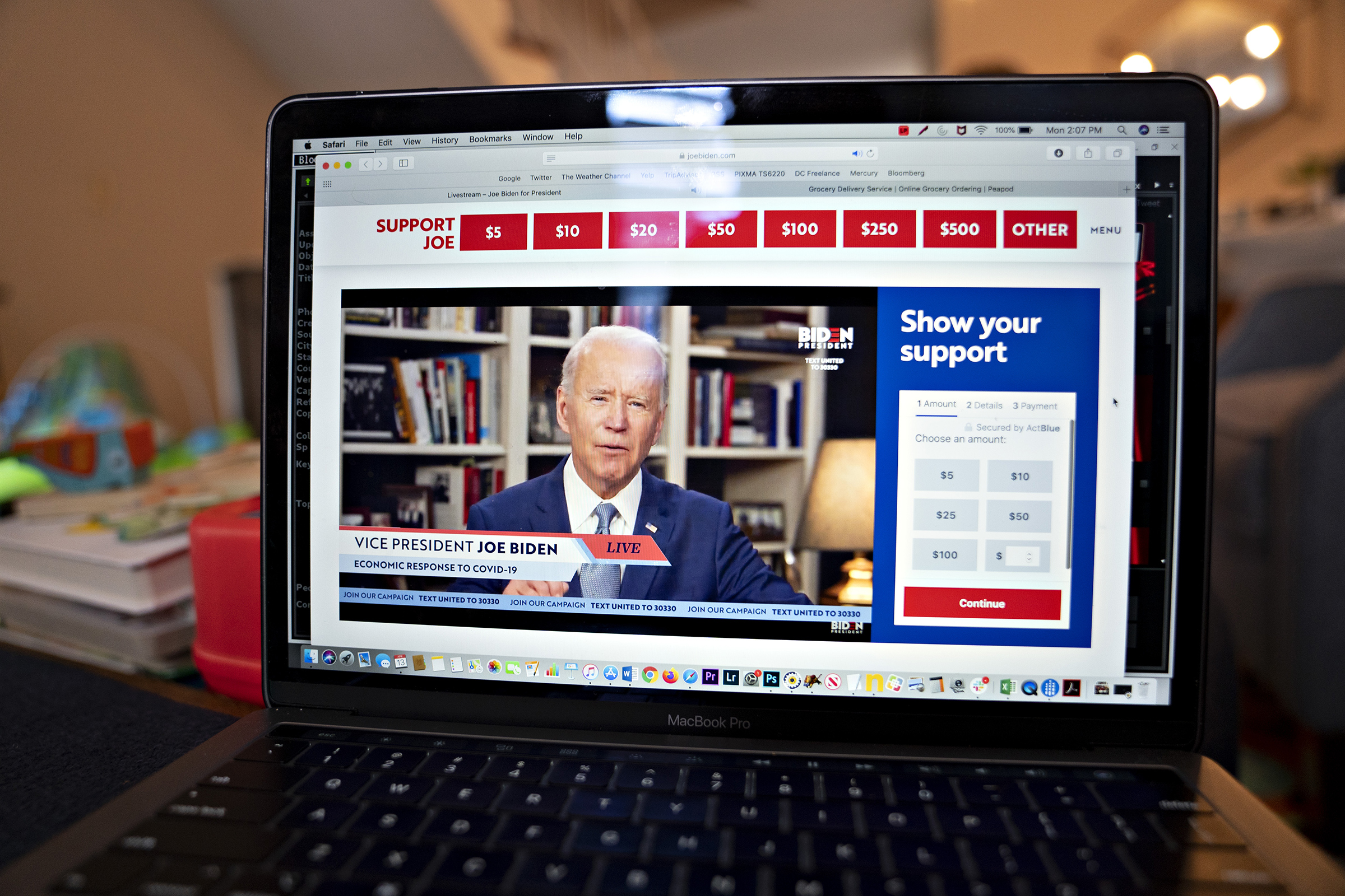 Former Vice President Joe Biden, presumptive Democratic presidential nominee, speaks during a virtual event seen on an Apple Inc. laptop computer in Arlington, Virginia, on April 13