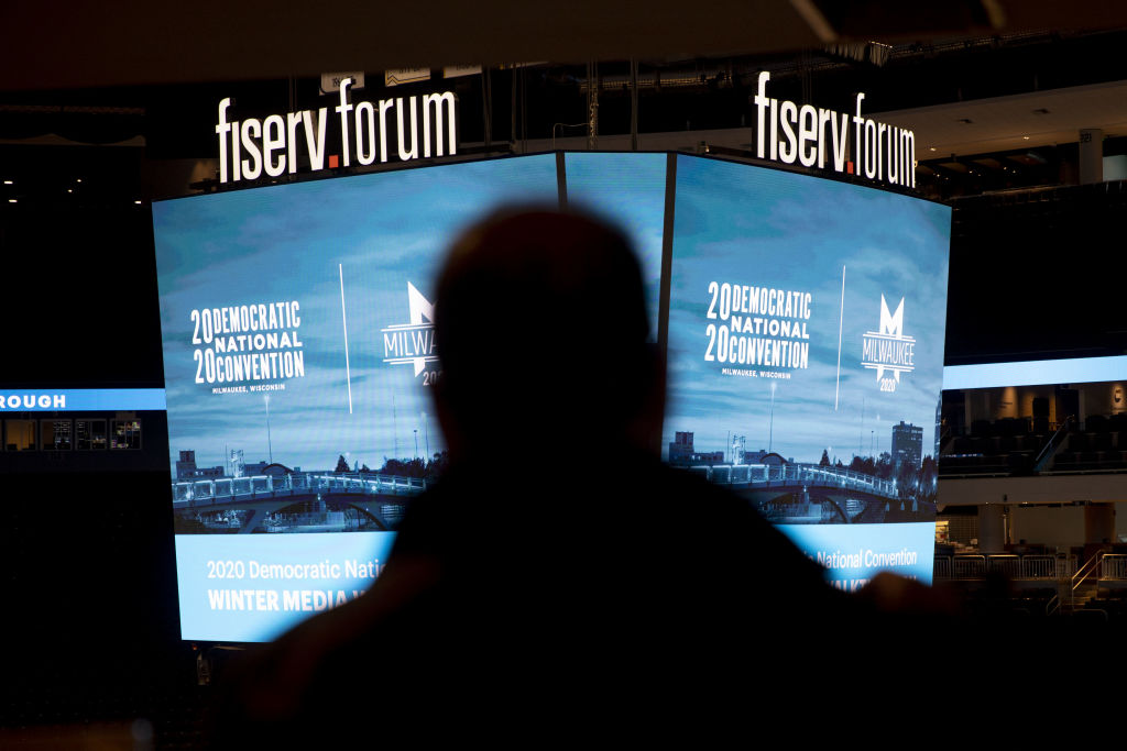 Signage is displayed during a media walkthrough for the upcoming Democratic National Convention (DNC) at the Fiserv Forum in Milwaukee, Wisconsin, on Jan. 7, 2020.