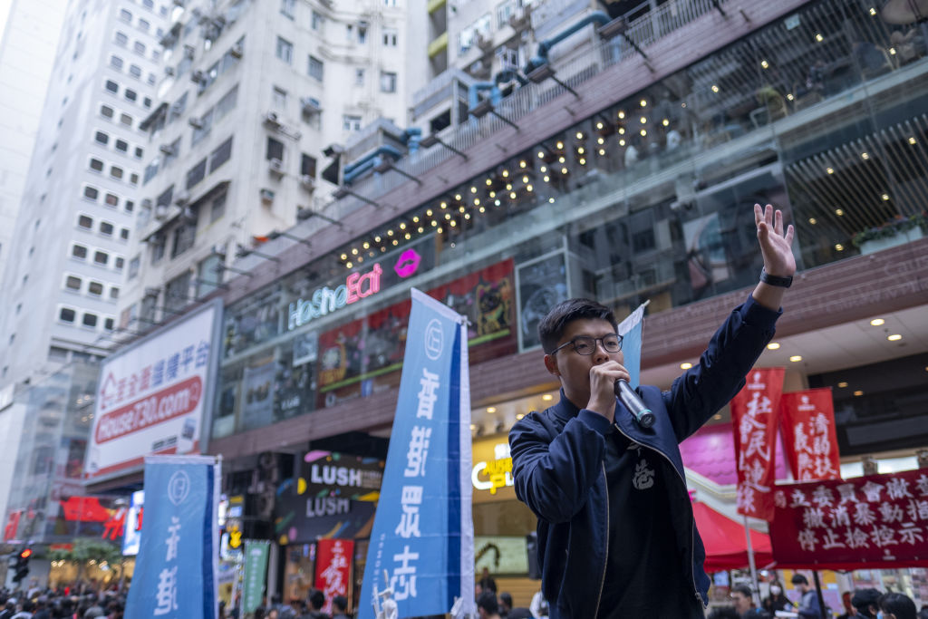 Prominent pro-democracy activist Joshua Wong speaks during a protest in Causeway Bay, Hong Kong on Jan. 1, 2020.