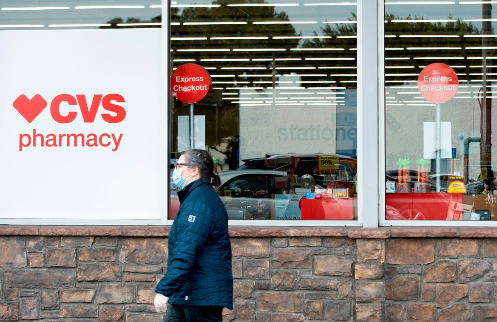 A person with a mask shops at CVS in Los Angeles during the COVID-19 crisis as California is under orders to stay home, March 31, 2020.