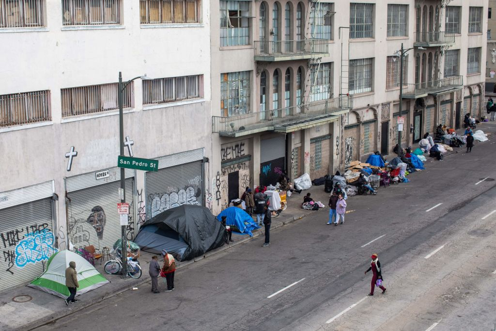 Homeless people make shelters on the sidewalk in Skid Row, downtown Los Angeles, California on March 19, 2020.