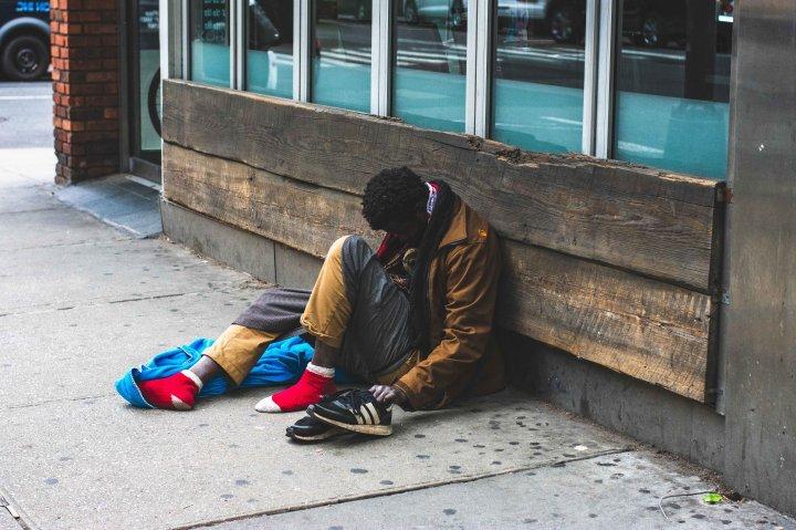 man-sitting-on-street-2239908-flip