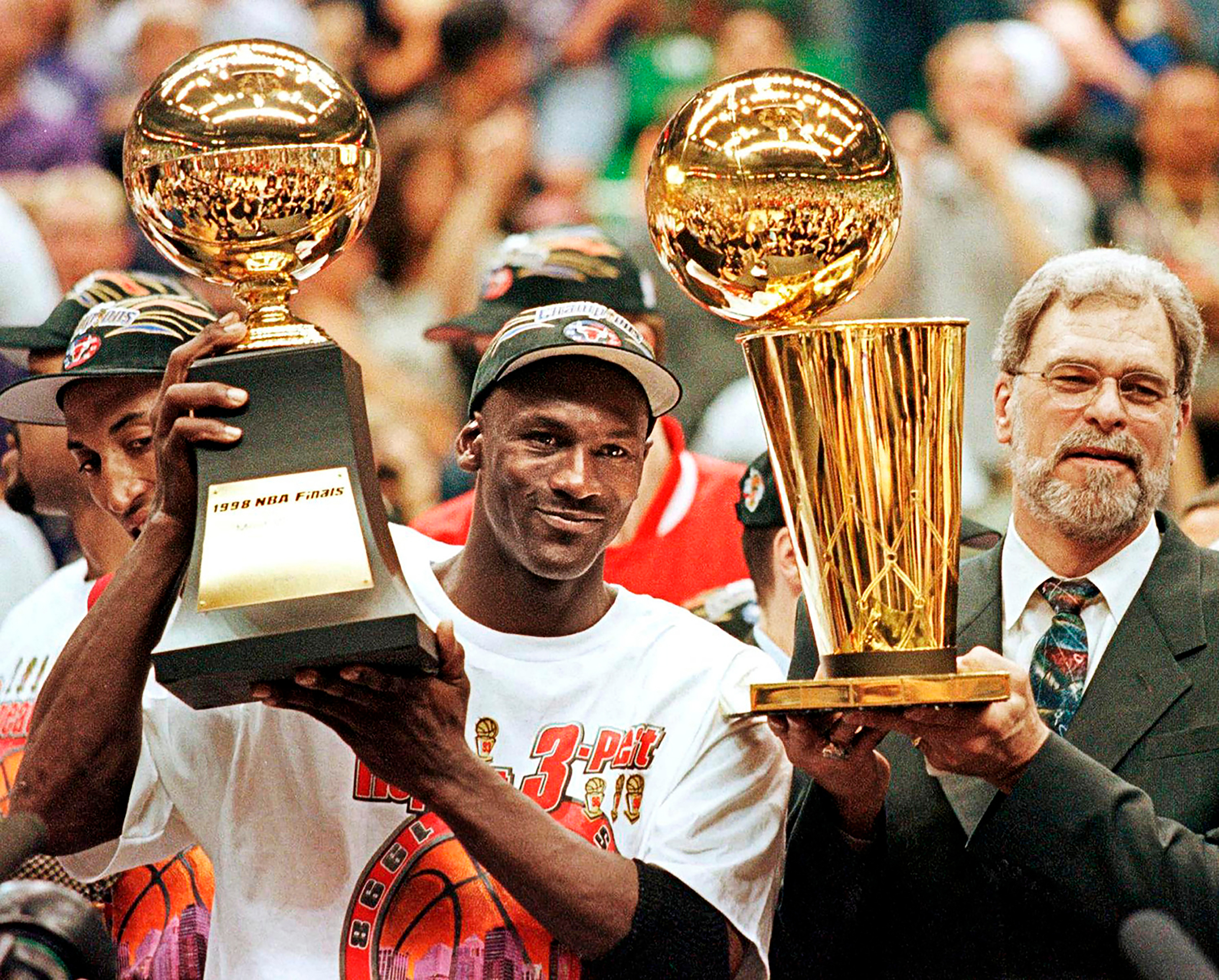 Michael Jordan celebrates his sixth, and final, title with coach Phil Jackson in 1998; both soon leave the Bulls.