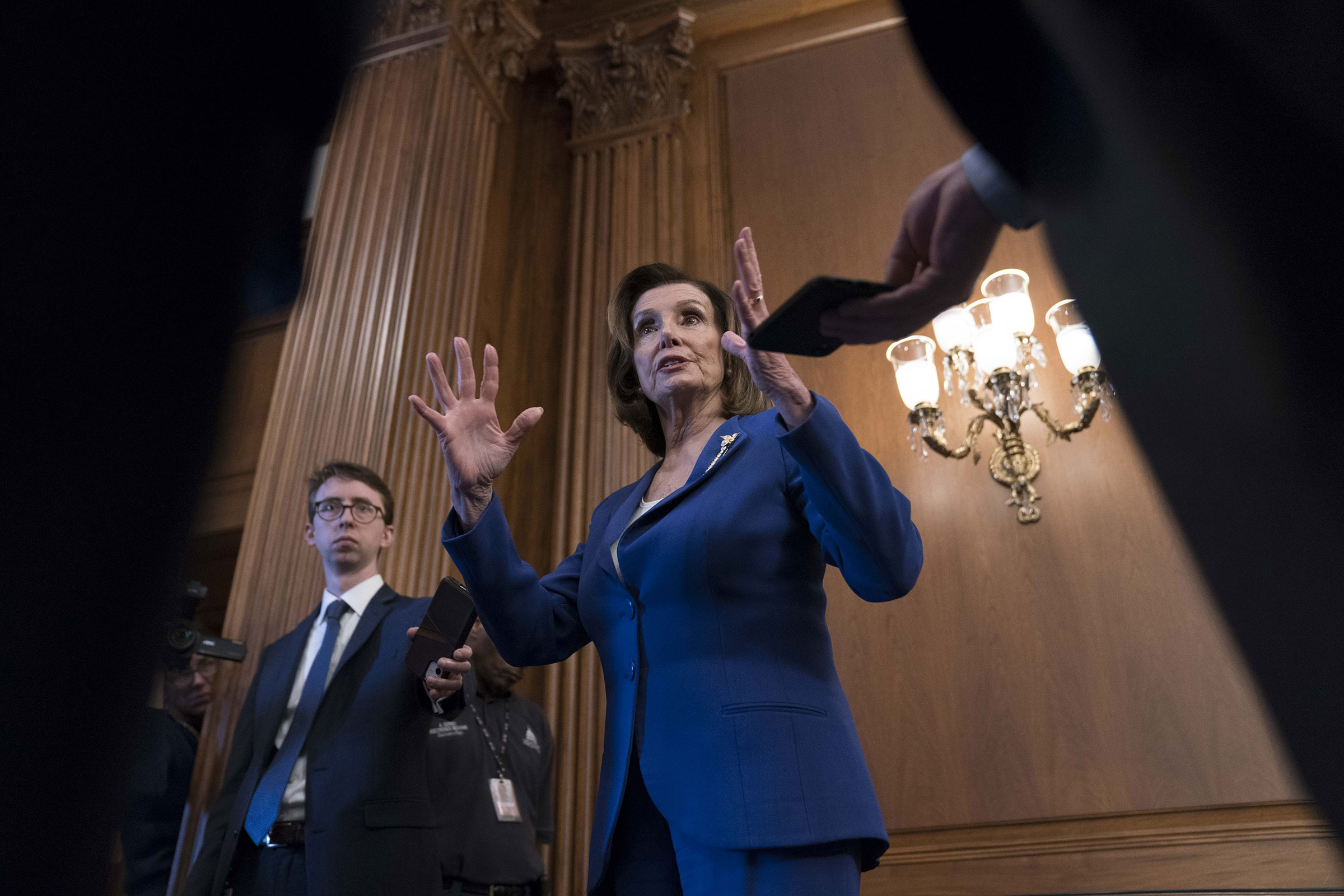 Pelosi, addressing the media on March 27, has been at the center of a rare burst of bipartisan legislation