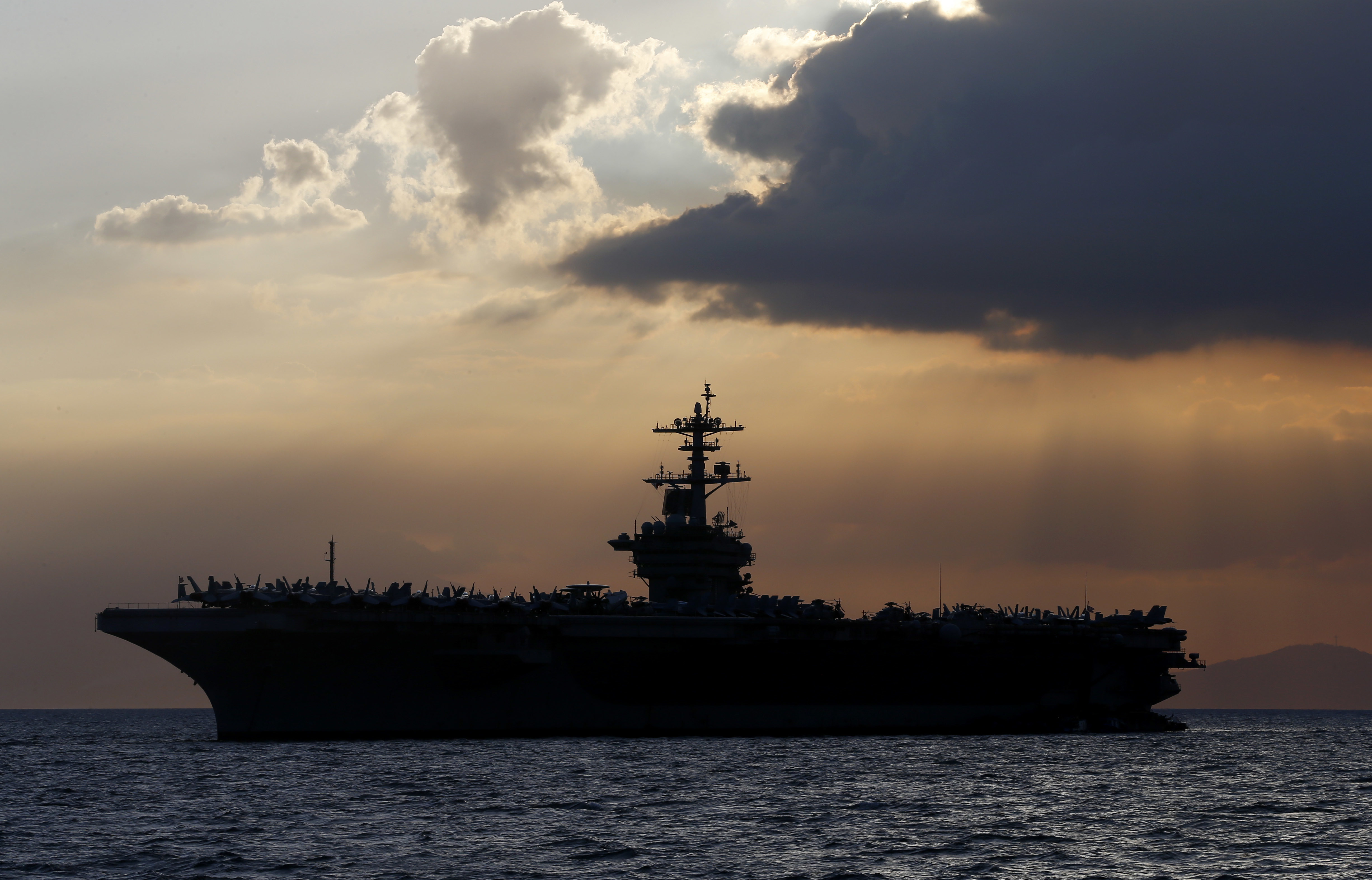 The USS Theodore Roosevelt aircraft carrier is anchored off Manila Bay west of Manila, Philippines, on April 13, 2018.