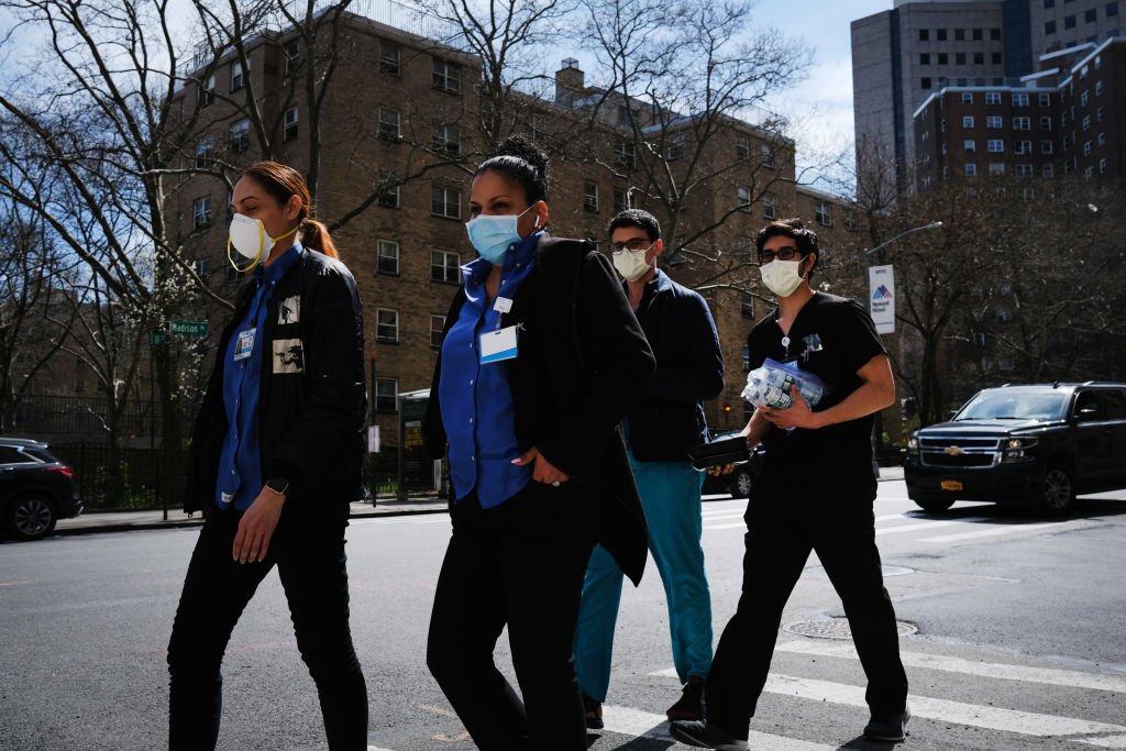 Medical workers walk outside of Mount Sinai Hospital amid the coronavirus pandemic on April 01, 2020 in New York City.