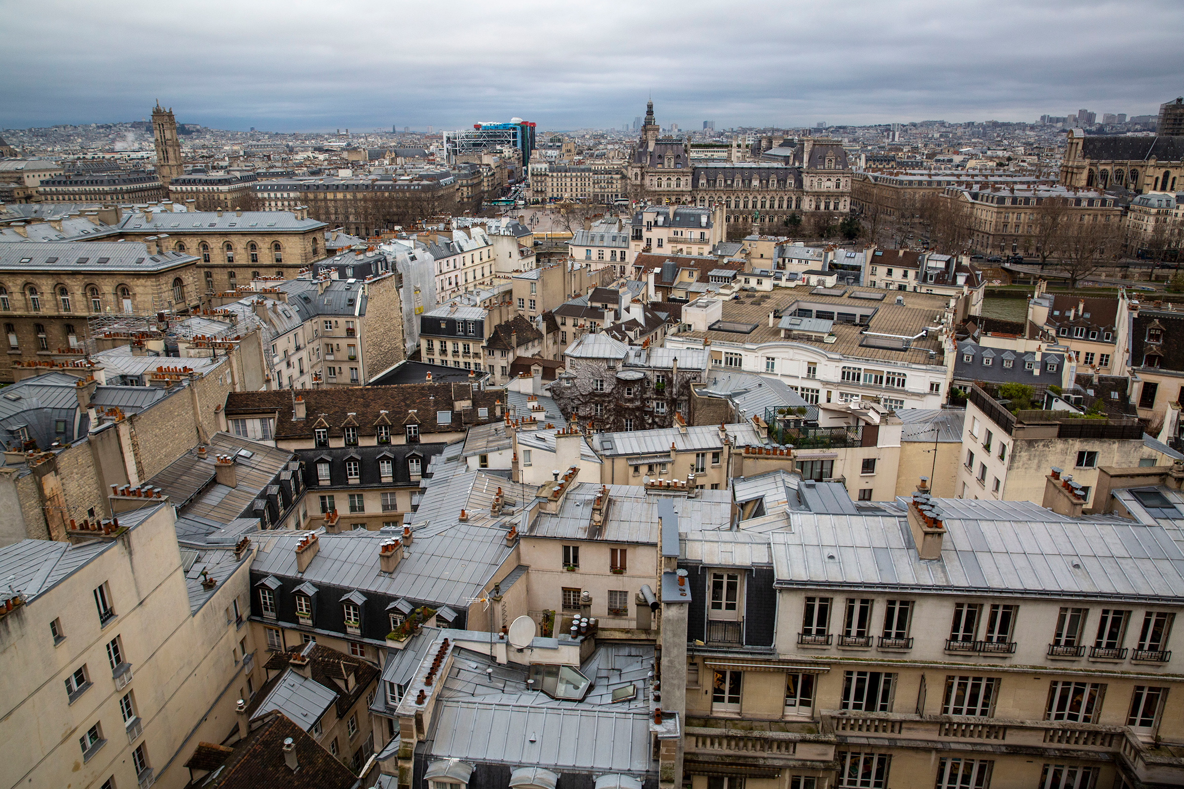 A view of Paris from Notre-Dame on Jan. 9. With 67 million French under a national lockdown since March 17, the cathedral sits shuttered and deserted.
