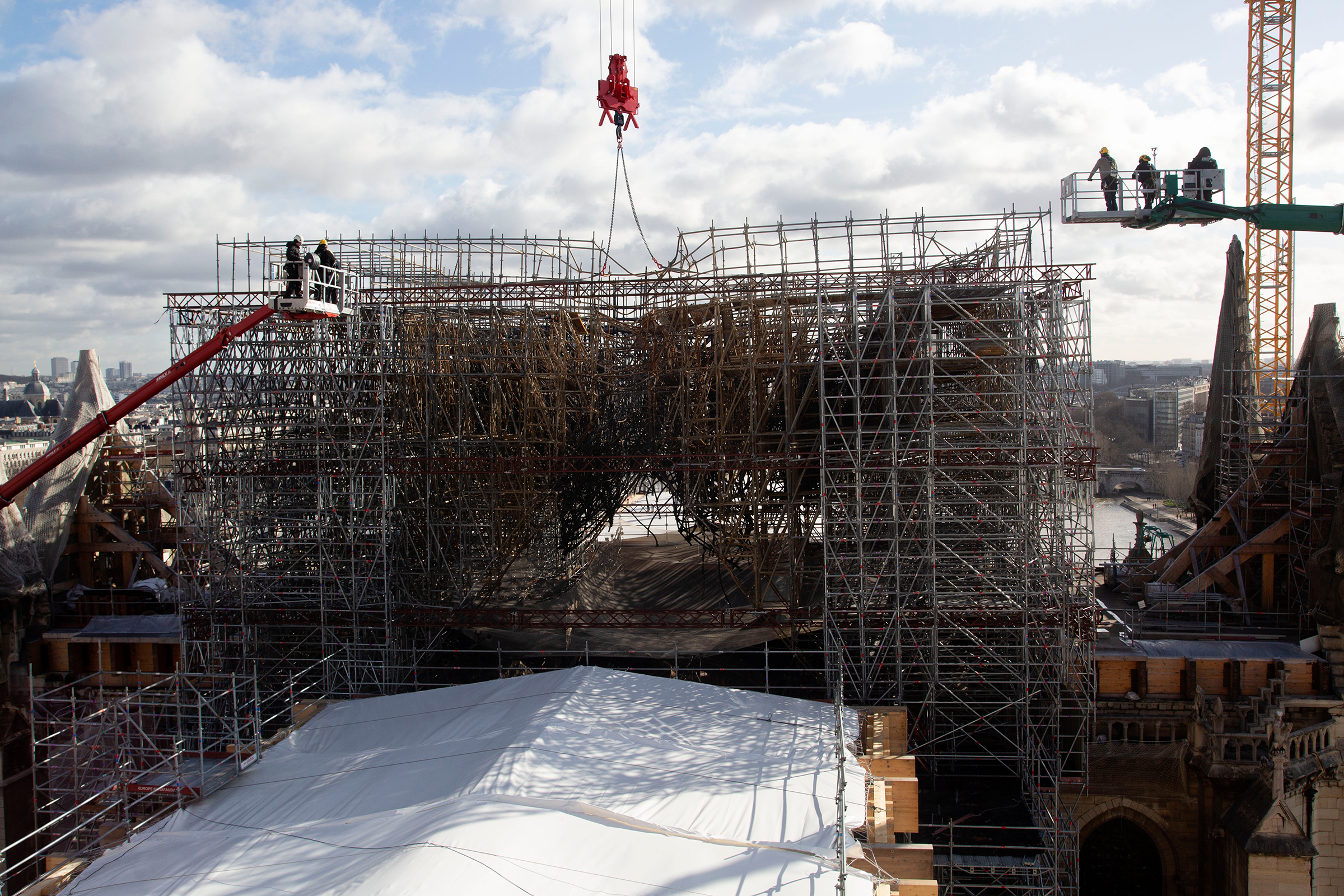 The most complicated reconstruction task is dismantling the twisted scaffolding, seen in February, that sits atop the cathedral.