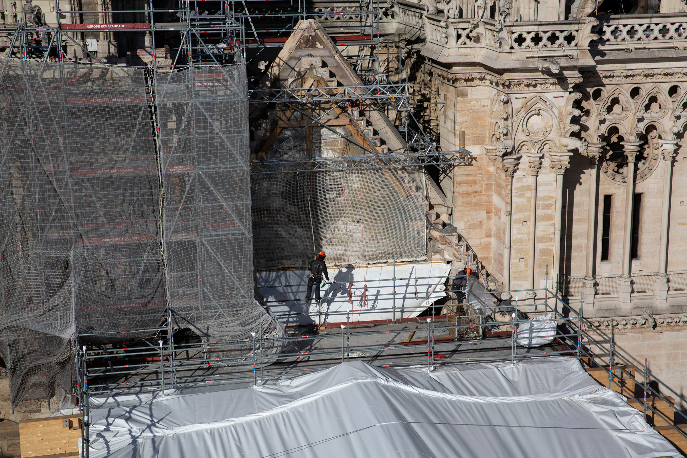 Macron's ambitious time frame for reopening Notre-Dame, seen in February, galvanized people into action and brought pledges of nearly a billion euros in donations for the reconstruction.