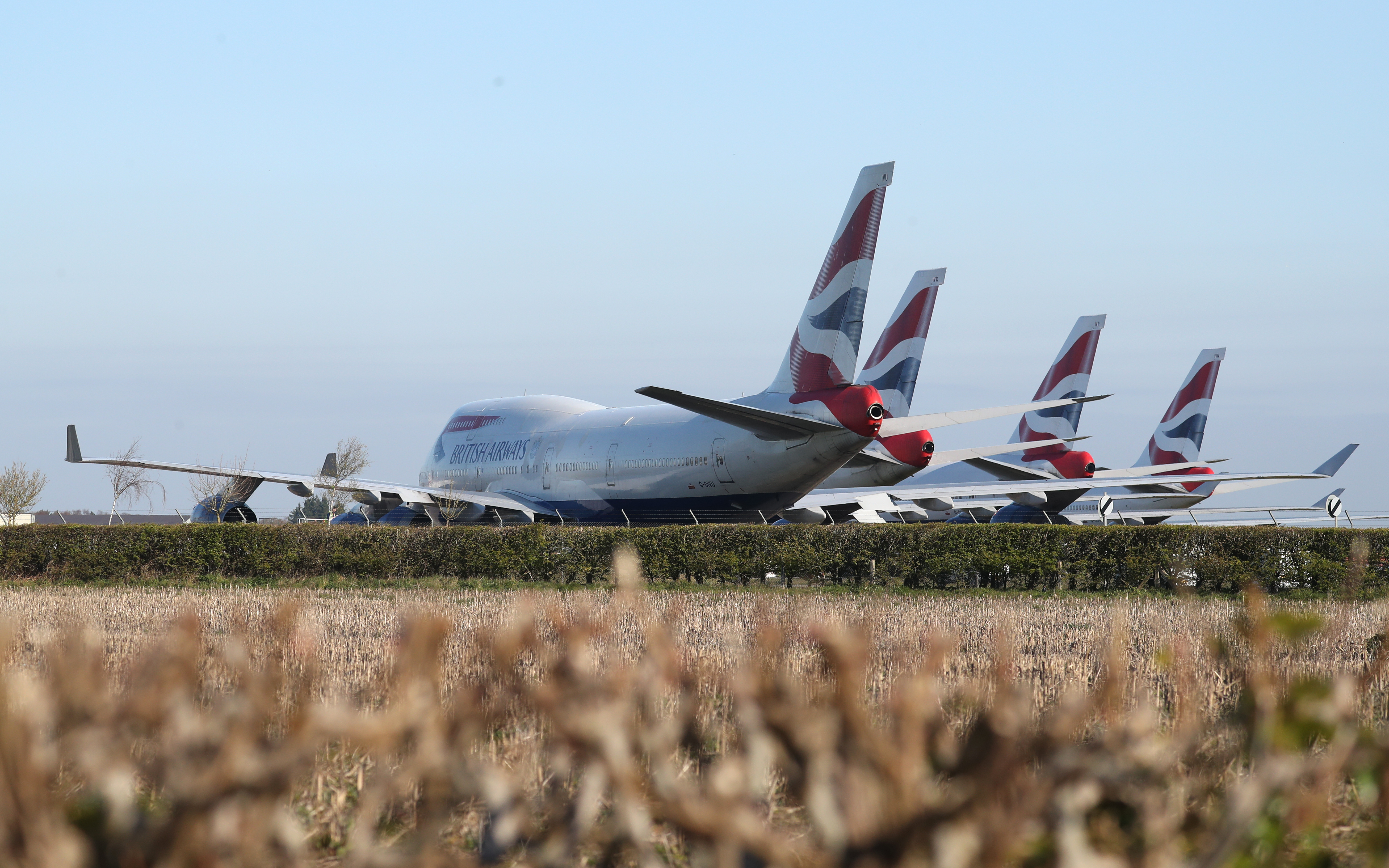 British Airways Boeing 747 aircraft parked at Bournemouth airport on April 1, 2020 after the airline reduced flights amid travel restrictions and a huge drop in demand as a result of the coronavirus pandemic.