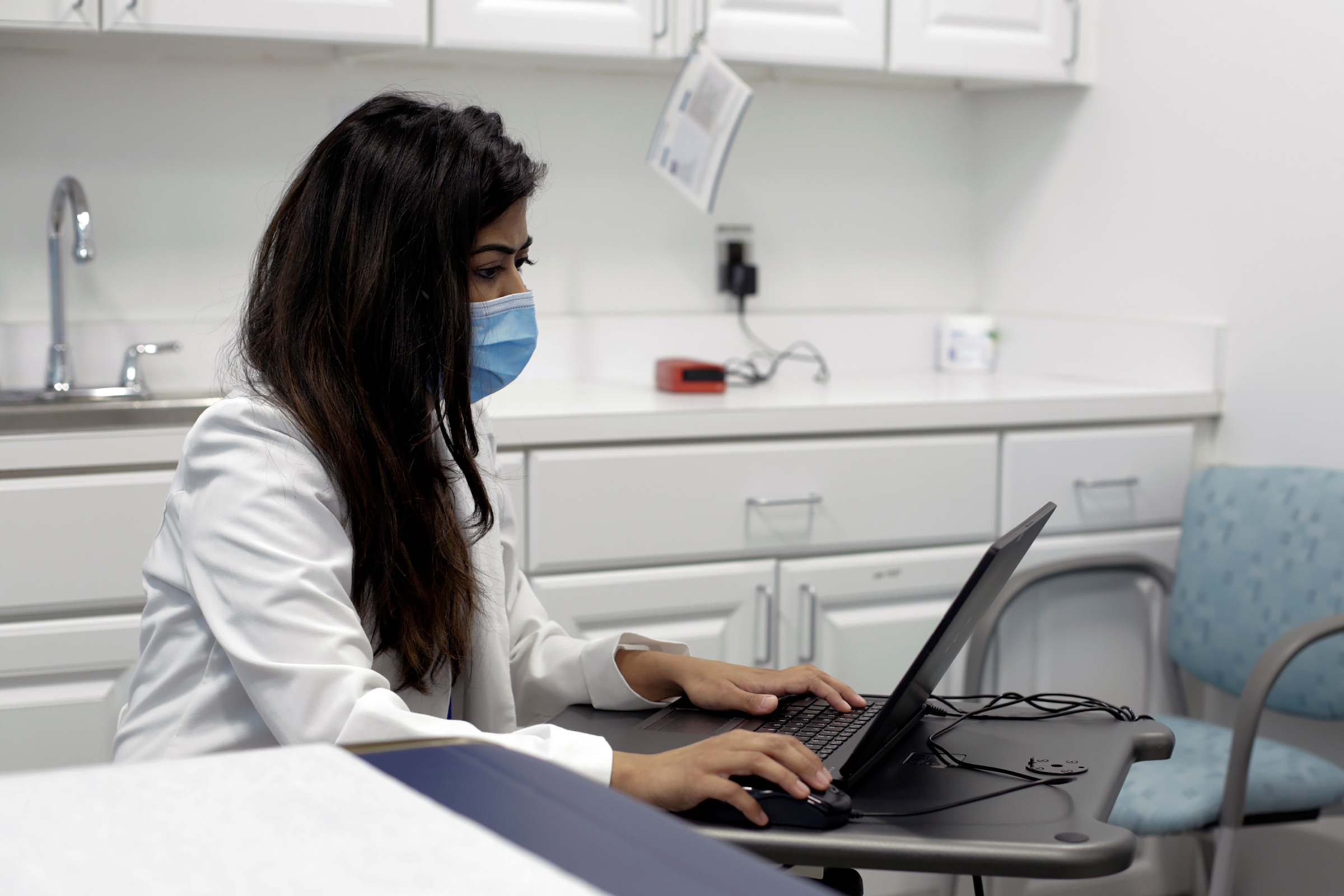 Dr. Meera Shah, the chief medical officer for Planned Parenthood Hudson Peconic, communicates with patients online in White Plains, New York, on April 3, 2020.