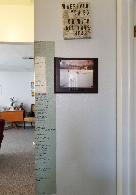 A wall in Mindy Pendleton's home showing the heights of her children