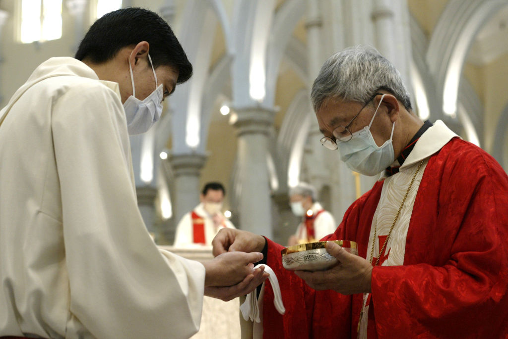 Hong Kong's Catholic Bishop Joseph Zen Ze-kiun attends a pre-Easter Mass at the Catholic Cathedral in the Mid Levels neighborhood of Hong Kong on April 17, 2003.