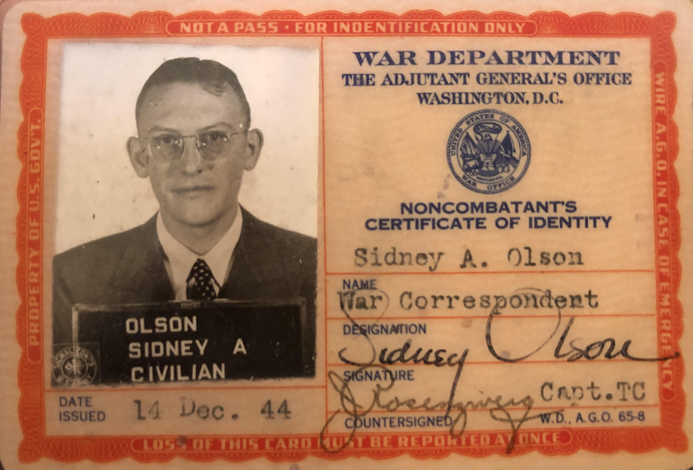 A noncombatant's certificate of identity issued to Sidney A. Olson designating him a war correspondent by the War Department on Dec. 14, 1944.