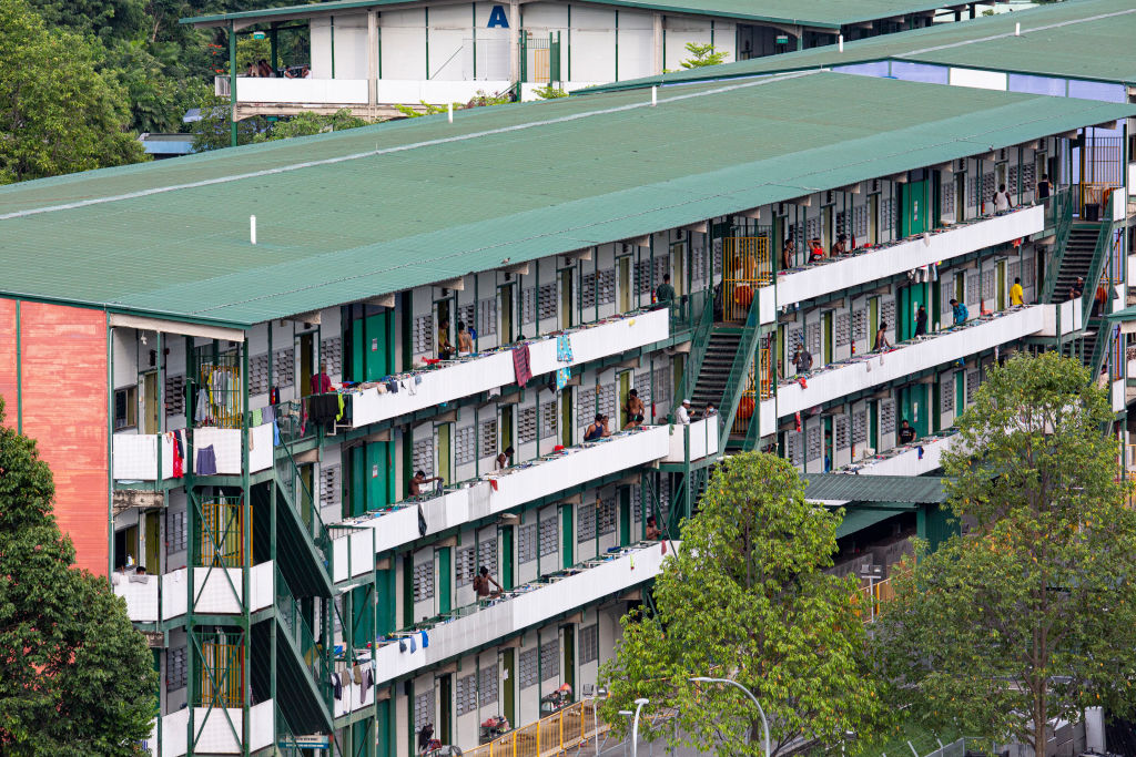 Residents are seen in a purpose-built migrant workers dormitory that was designated as an isolation area in Singapore on April 18, 2020.