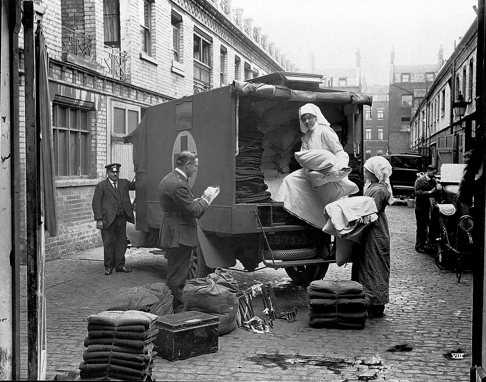 Loading up blankets into an ambulance in Gower Mews, London, in September 1918.