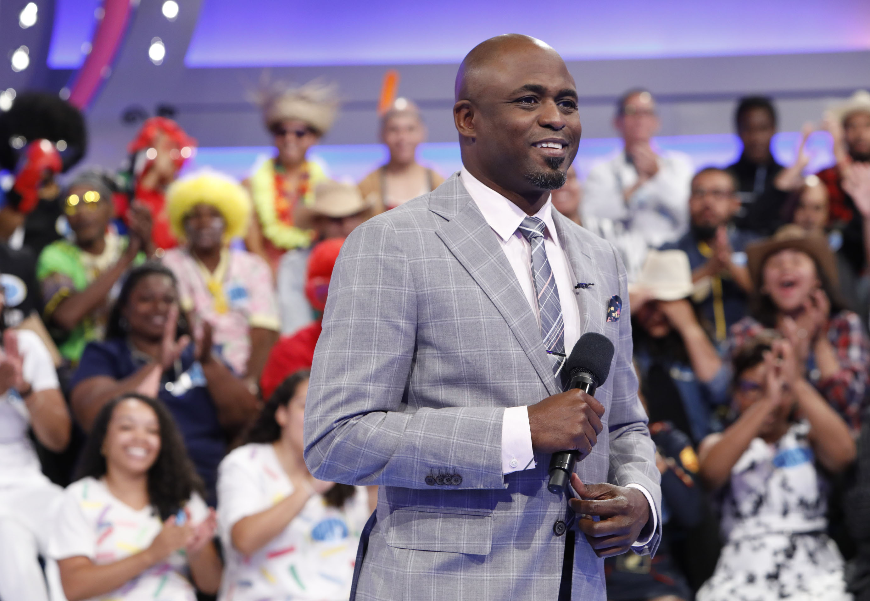 This image released by CBS shows host Wayne Brady on the set of the gameshow  Let's Make a Deal.