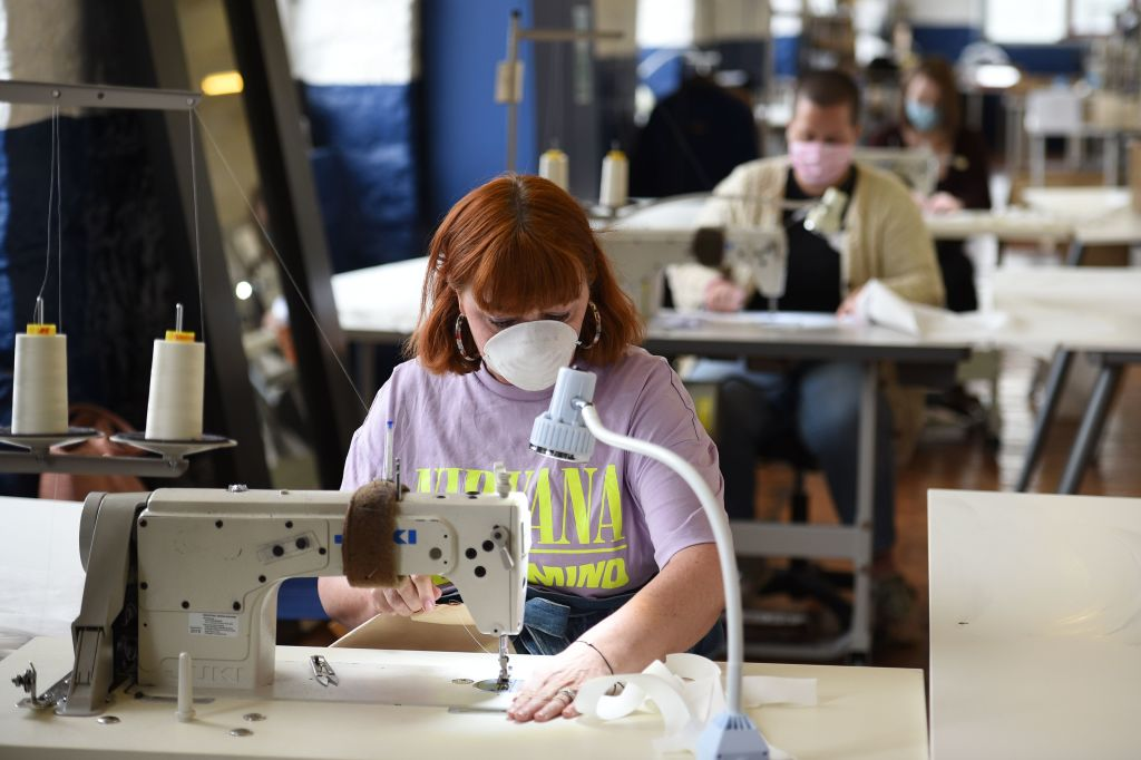 Machinists sew gowns at shirtmaker McNair, who have changed production to making gowns for the Huddersfield Royal Infirmary, in Slaithwaite, northern England, on April 17, 2020, during the nationwide lockdown to combat the novel coronavirus COVID-19 pandemic.