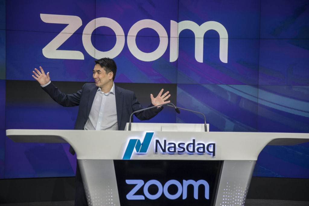 Eric Yuan, founder and chief executive officer of Zoom Video Communications Inc., stands before the opening bell during the company's initial public offering (IPO) at the Nasdaq MarketSite in New York, U.S., on Thursday, April 18, 2019.