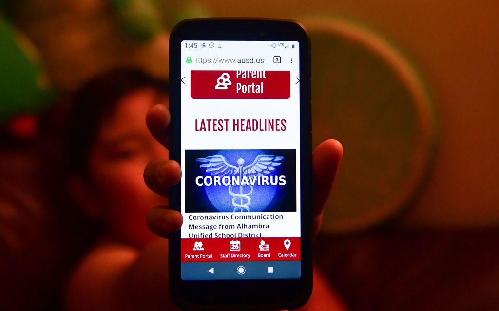 The Parent Portal information on coronavirus from the Alhambra Unified School District is displayed on a cellphone on Feb. 4, 2020 in Alhambra, Calif