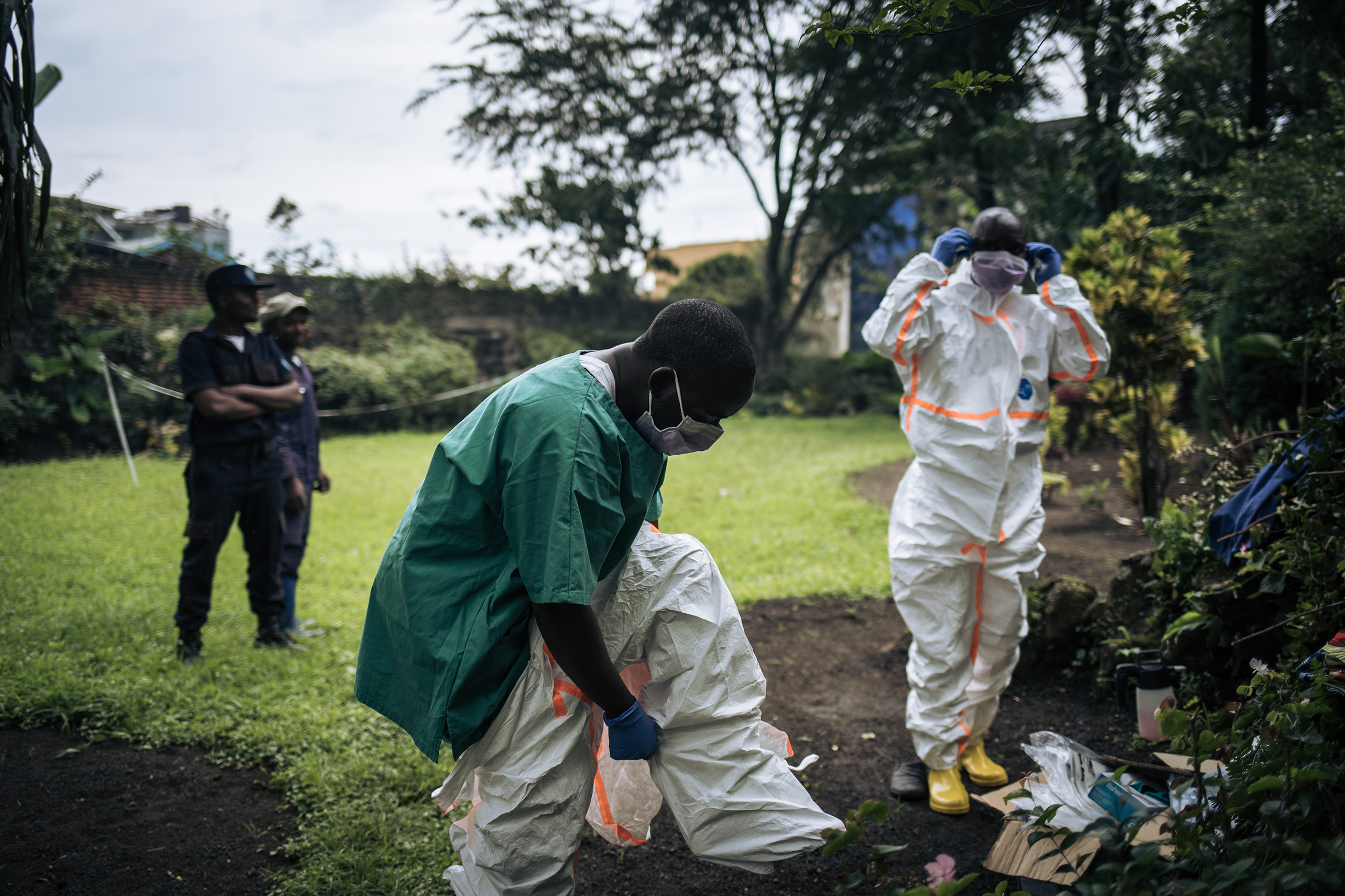 Two staff members of the Congolese Ministry of Health wear PPE to perform a COVID-19 in Goma, Democratic Republic of Congo, on March 31, 2020.