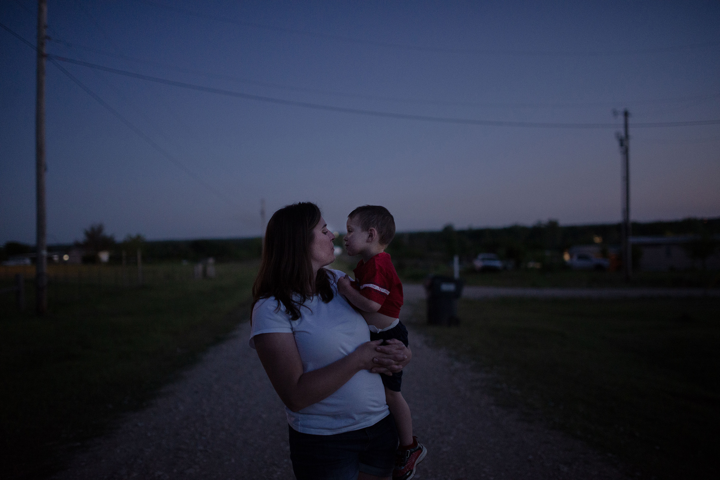 "Christina Thomason 39, and son Logan, Tecumseh, Okla. ""You can't tell people to stay home and not care for them. I'm watching everything we worked for being flushed down the toilet. How are we going to come back from this?"" she says."