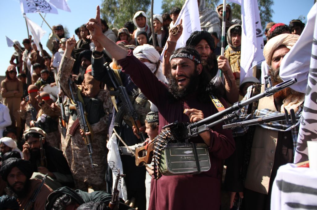 Afghan Taliban fighters and villagers attend a gathering as they celebrate the peace deal signed between the U.S. and the Taliban in Laghman Province on March 2, 2020.