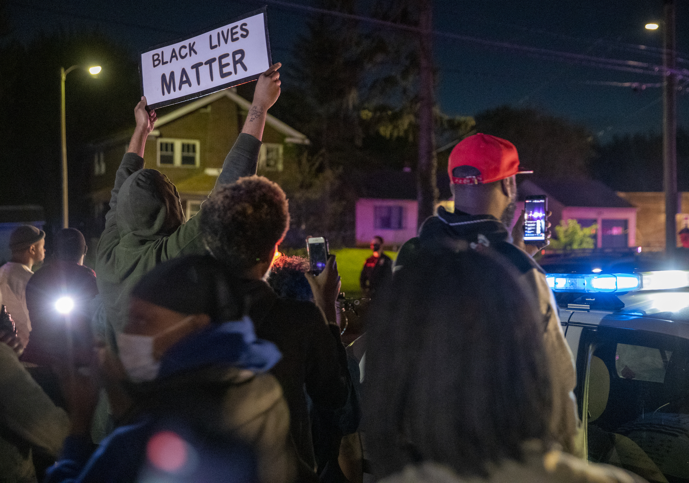 In this Wednesday, May 6, 2020 photo, community members protest in Indianapolis, hours after a man was killed during an Indianapolis police involved shooting which was apparently captured in part on Facebook Live video.