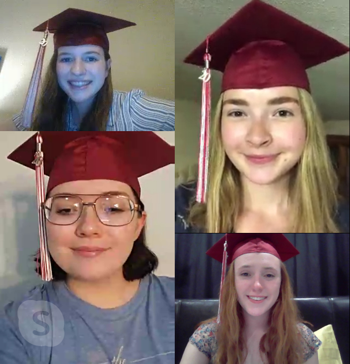 Lauren has a Skype call with her friends in their graduation caps.