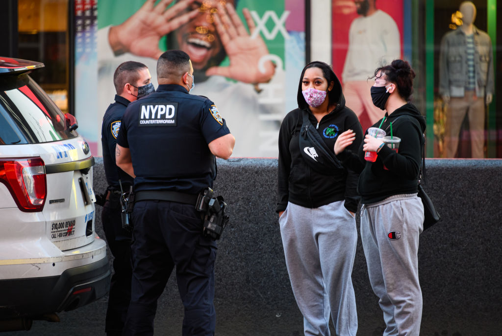 NEW YORK, NEW YORK - MAY 13: Members of the New York City Police Department Counterterrorism Bureau stand in Times Square during the coronavirus pandemic on May 13, 2020 in New York City. The NYPD will take a step back in their social distancing enforcement after multiple violent incidents at the hands of police officers drew widespread criticism.