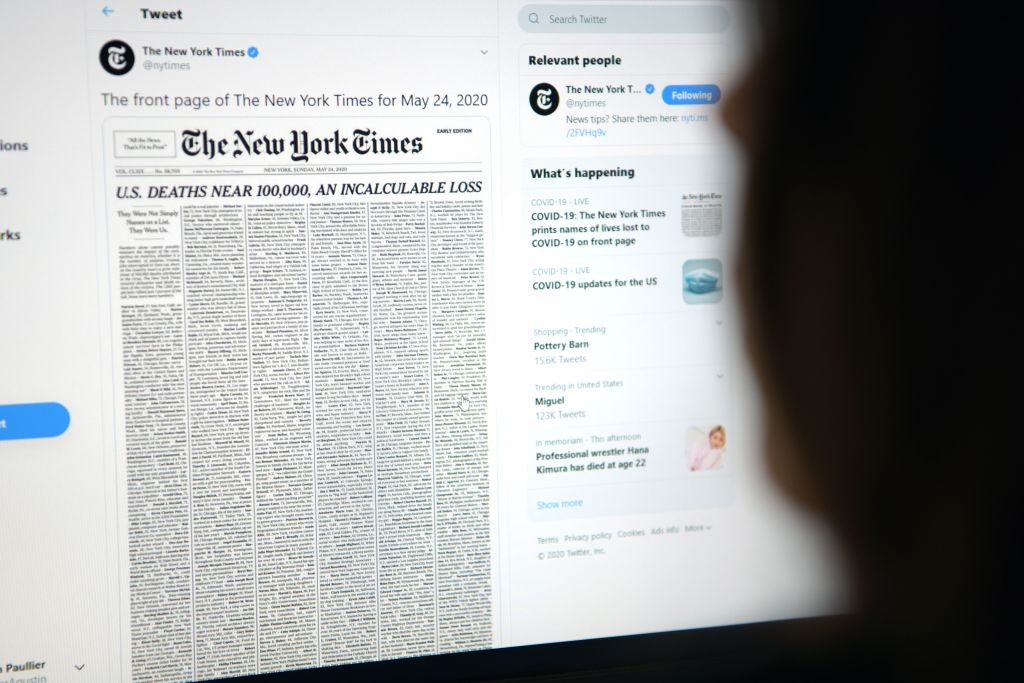 A woman looking at a computer screen with a tweet by the New York Times newspaper account showing the early edition front page of May 24, May 23, in Los Angeles, Calif.