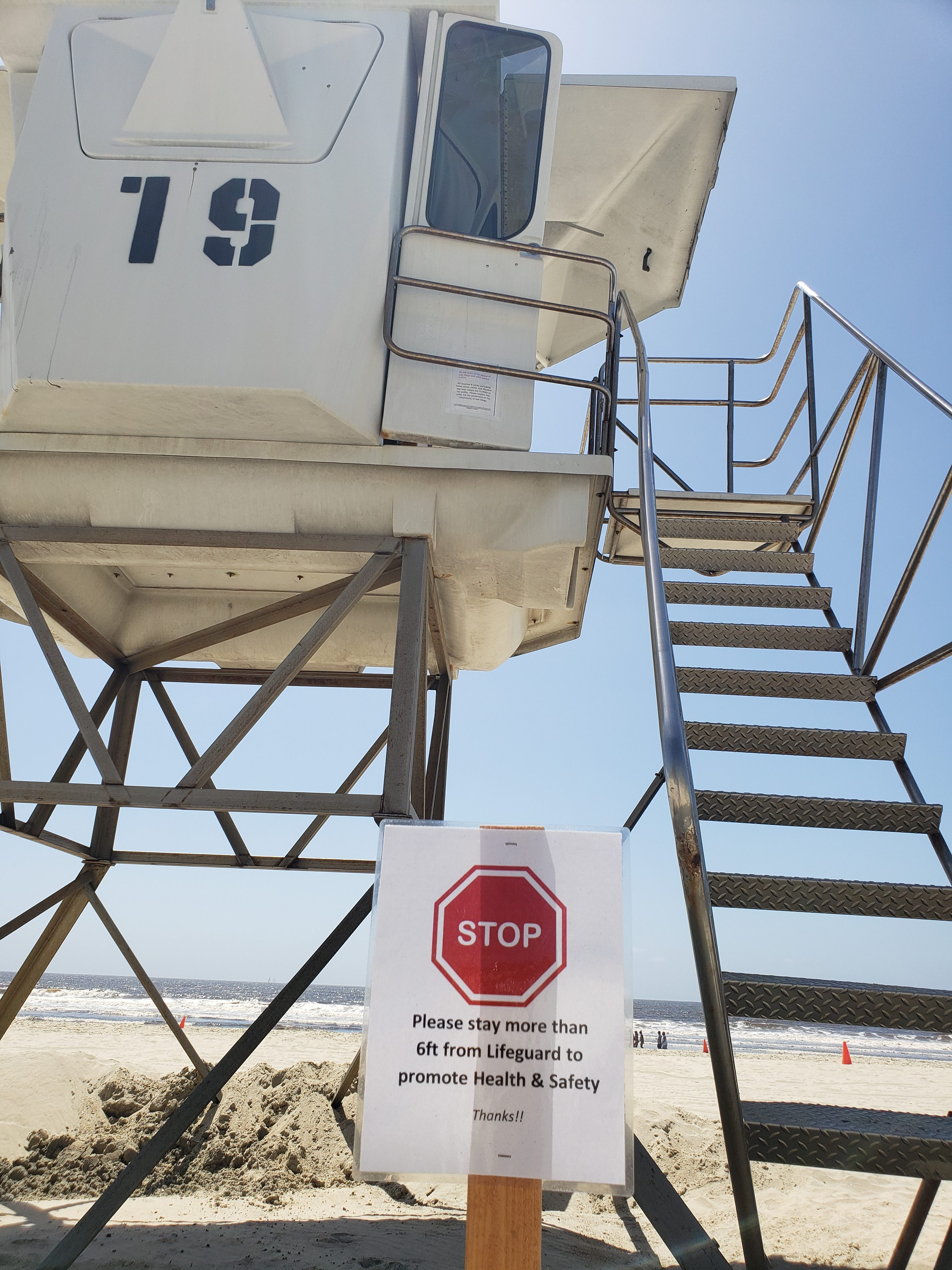 A sign outside of a lifeguard tower on a beach in San Diego, Calif.