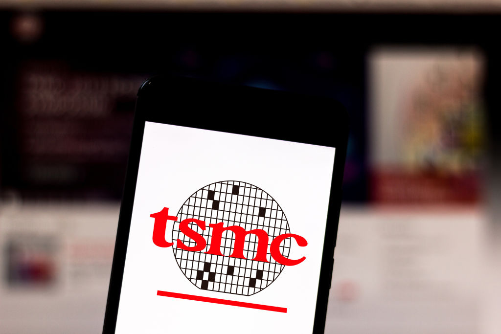 In this photo illustration the Taiwan Semiconductor Manufacturing Company (TSMC) logo is seen displayed on a smartphone.